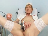 Mature Nurse Self Exam on Gynochair With Speculum