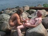 Old Uncle Is Having Great Time Together With 2 Teens In Nature and on the Beach